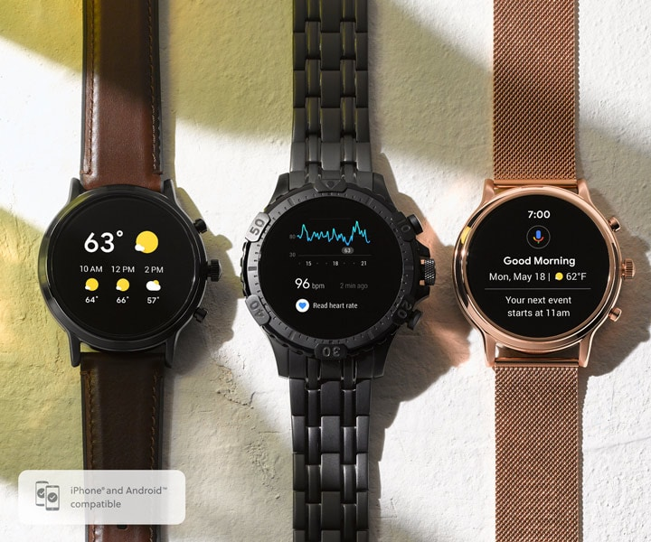 Three Gen 5 smartwatches in steel and leather straps.