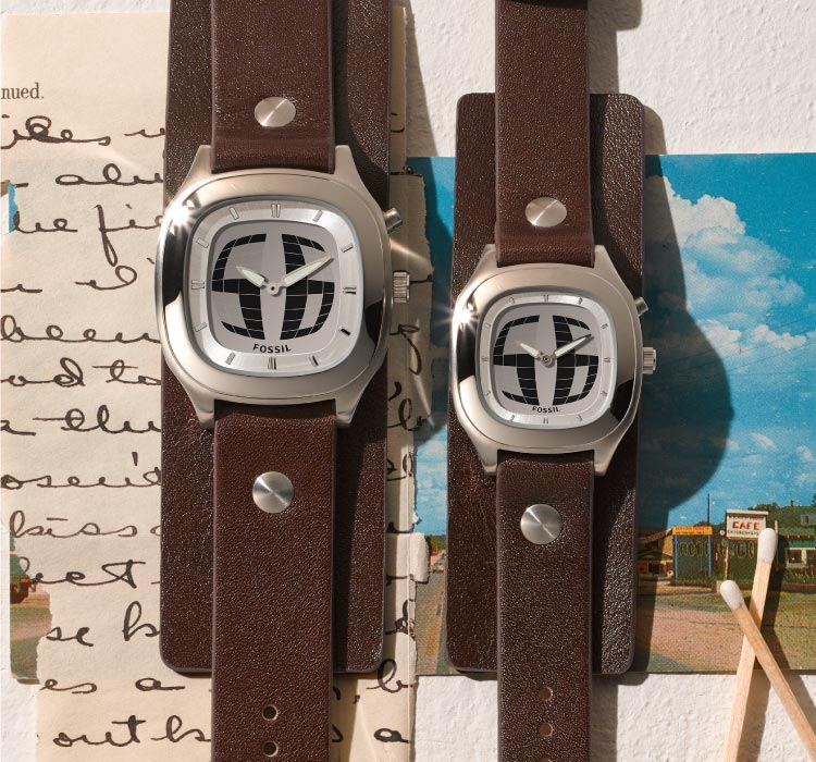 two big tic watches with a map and letters