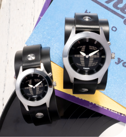 two big tic watches sitting on papers