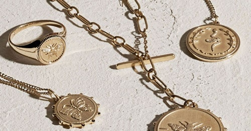 Five gold-tone jewelry pieces from the Vintage Coin collection.