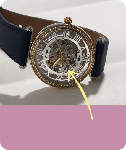 a mechanical watch with an arrow pointing to a highlighted item