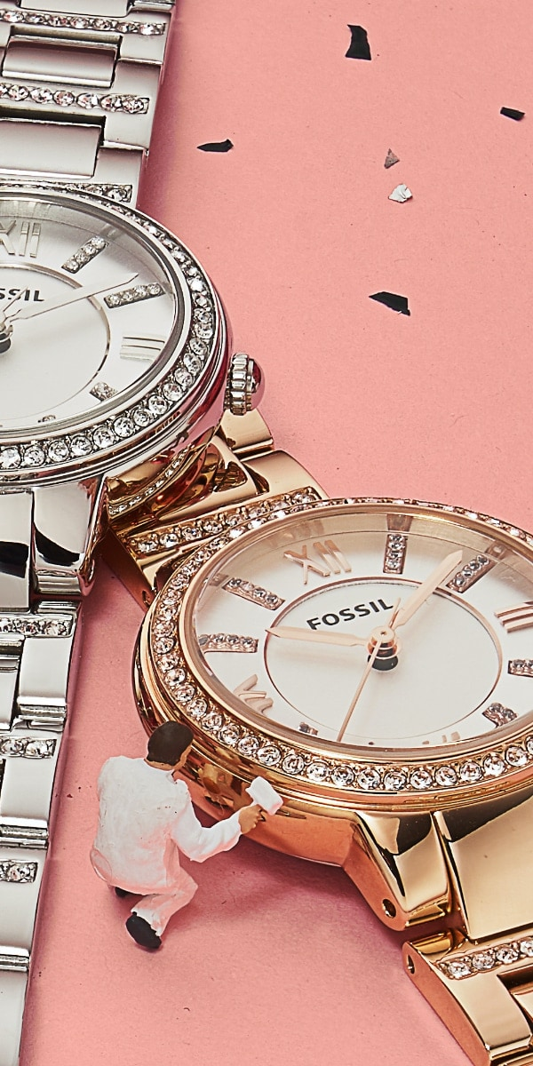 Women's stainless steel watch with glitz and gold-tone watch with glitz.