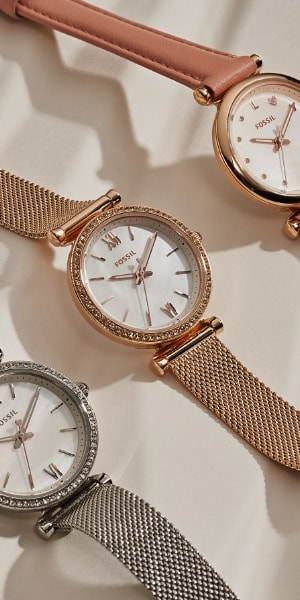 Three Carlie Mini watches.