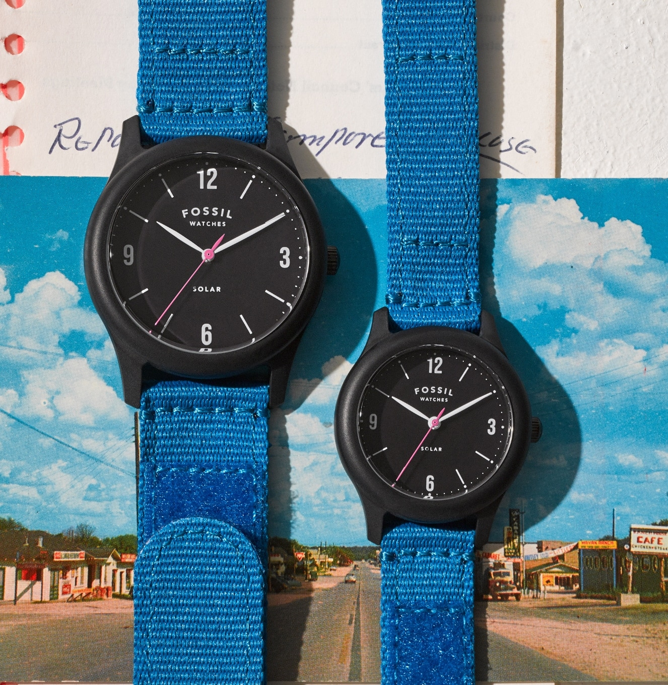 Two Limited Edition Solar Watches on a postcard.