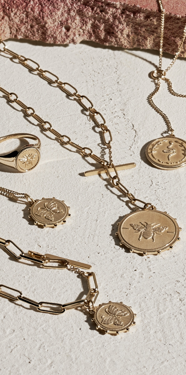Five gold-tone jewellery pieces from our Vintage Coin collection.
