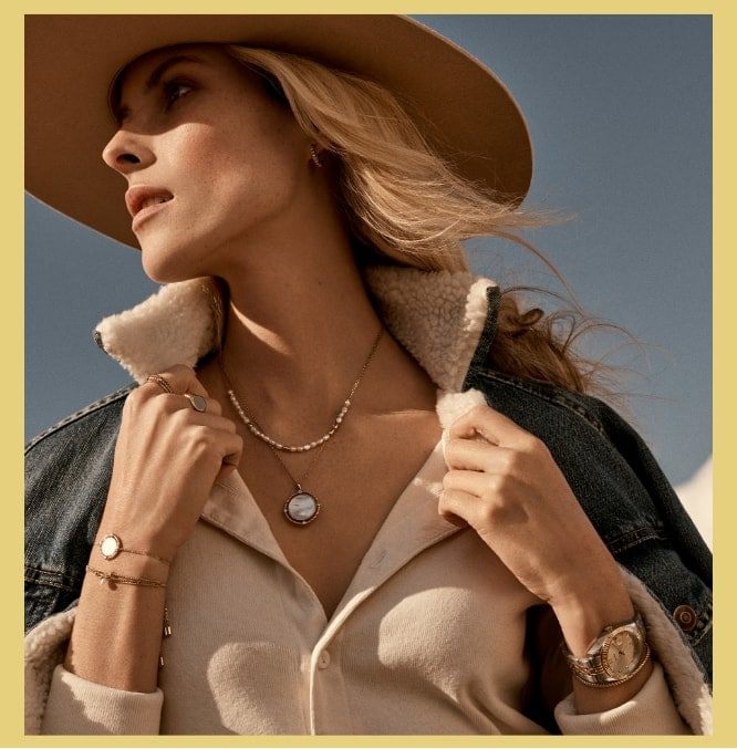 Vintage Heritage Collection. Woman wearing gold-tone jewelry and a close-up of gold-tone earrings, necklaces and rings.