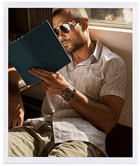 A Hybrid HR Smartwatch with feature icons and a man wearing a Hybrid HR while reading a book.