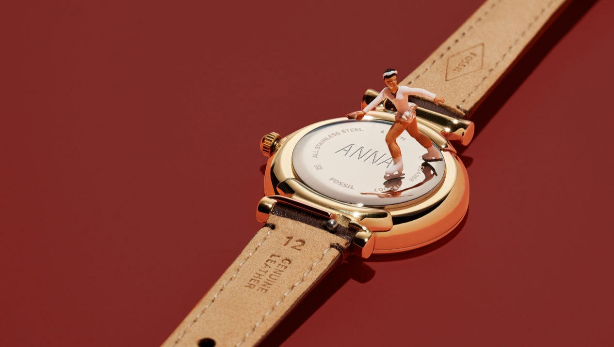 a watch with engraving on the back