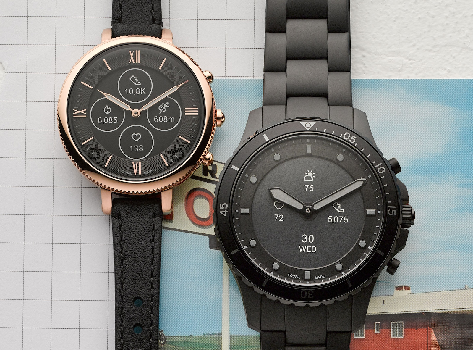 Two Hybrid HR Smartwatches on a textured background.