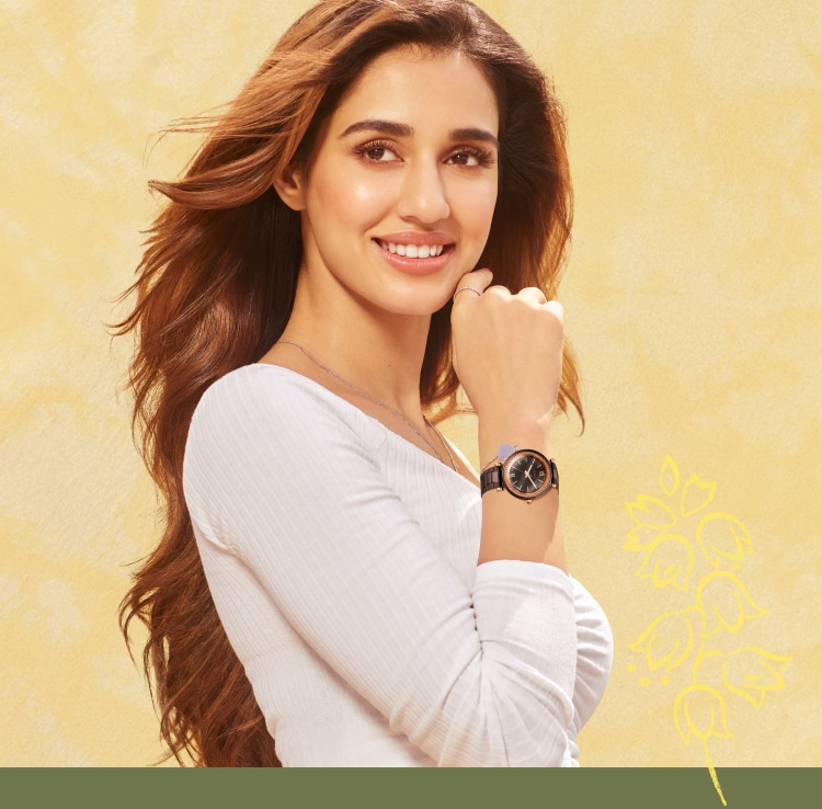 Disha Patani wearing a black ceramic Fossil watch.
