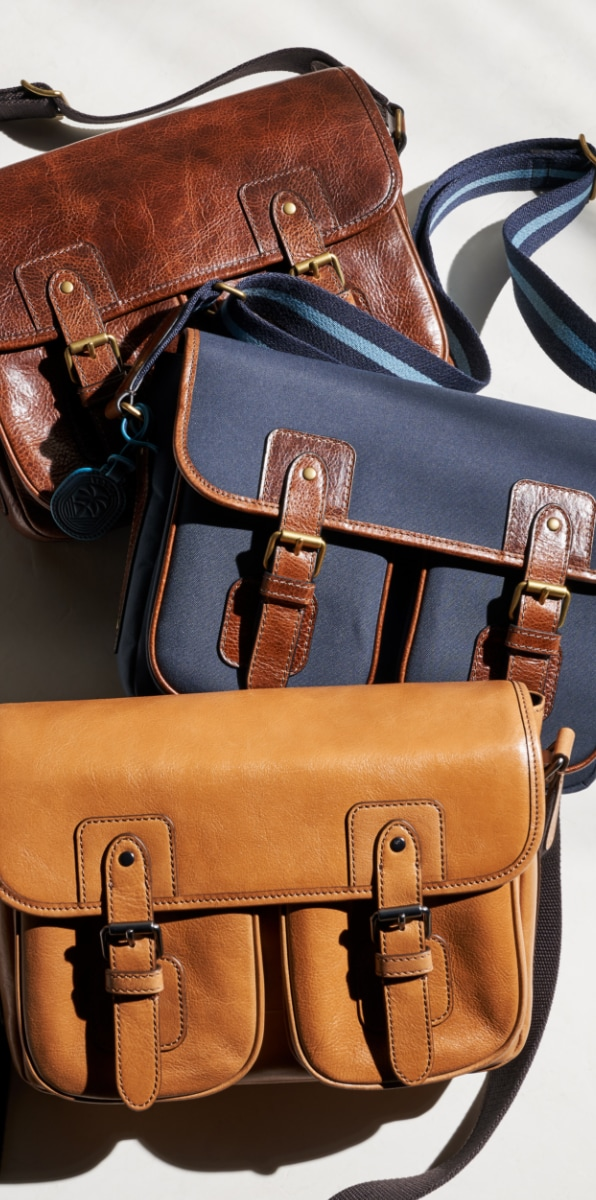 Three men's Greenville courier bags.