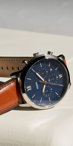 A brown leather Neutra watch with blue dial.
