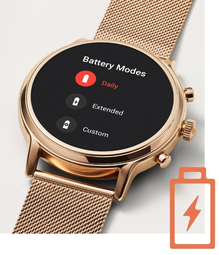 Woman smiling wearing a Gen 5 smartwatch.