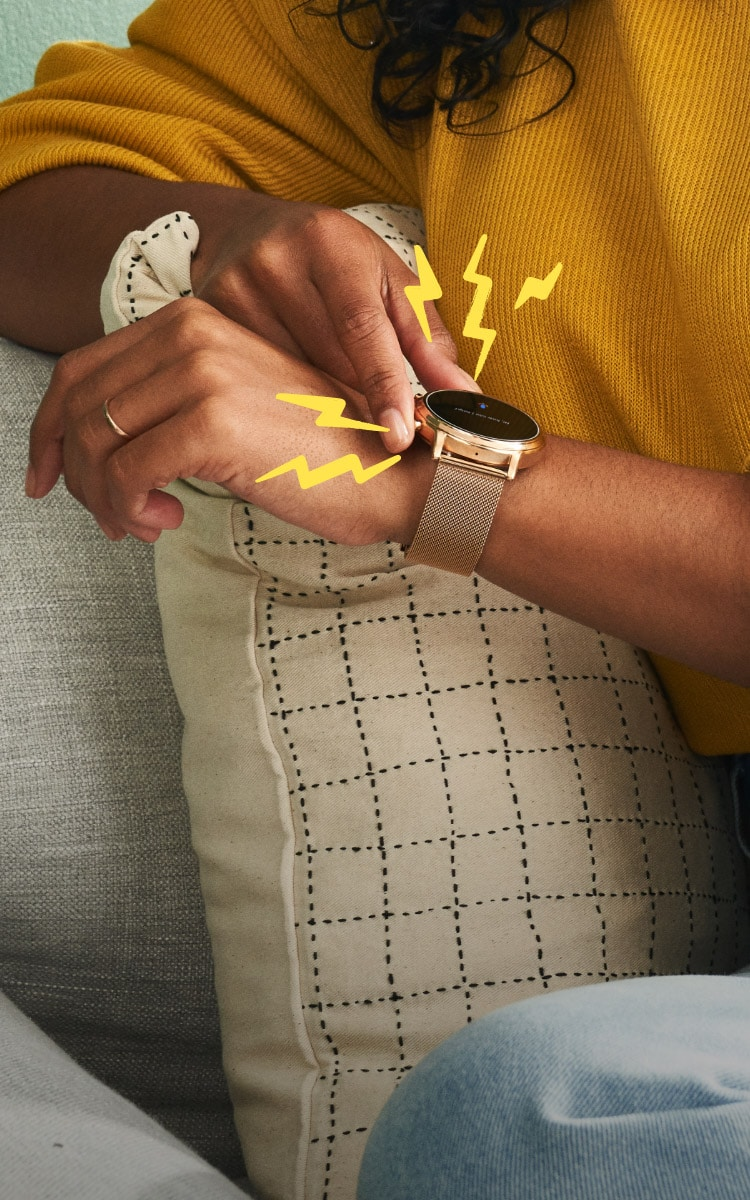 A woman checks her messages on a Gen 5 smartwatch.