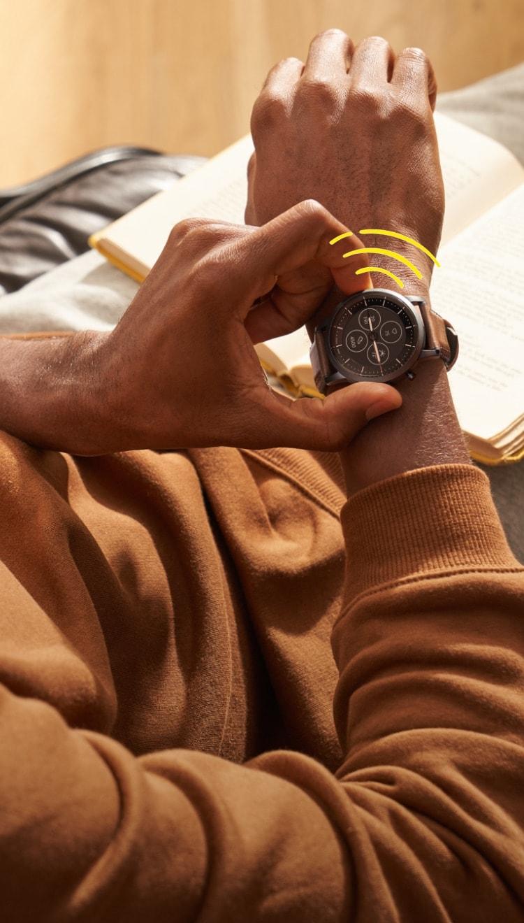 A man wearing a buzzing Hybrid Smartwatch HR.