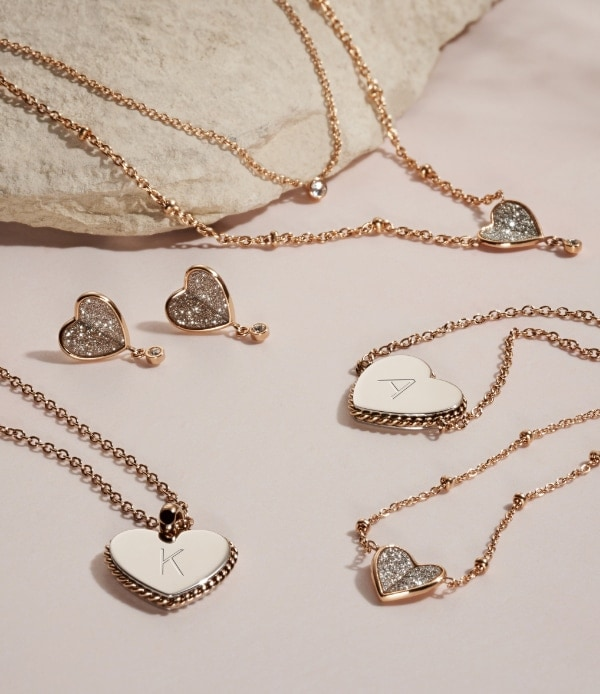 Women's gold-tone engravable heart jewelry collection.